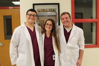 Three Surgical Technology students