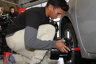 Automotive student fitting brakes