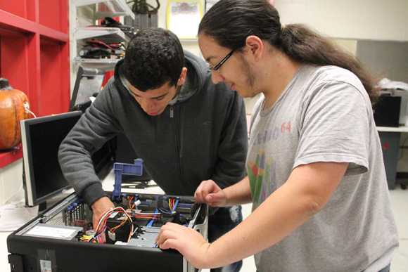 Two students investigate the workings of a computer