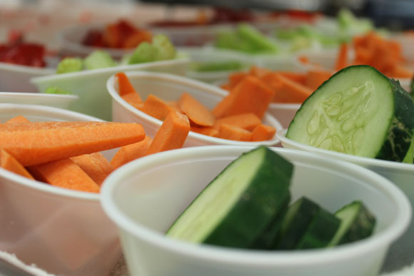 Sliced cucumbers and carrots in serving cups