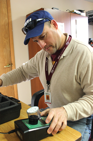 Environmental Health and Safety Technician performs a compliance test