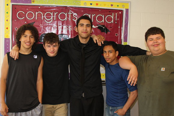 A group of five boys after their moving up ceremony