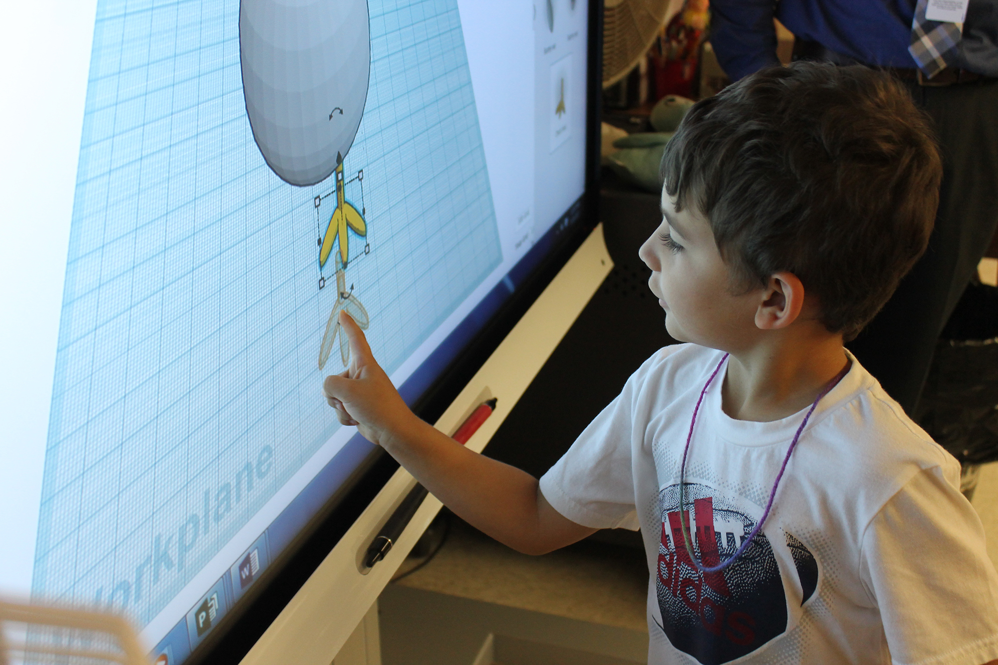 Ostrander Elementary School Kindergarten student designs a project.